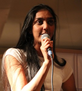 "Kasha Patel ('12) on her 23rd birthday when she hosted her first science comedy show, ""This Scientist Walks Into a Bar."""