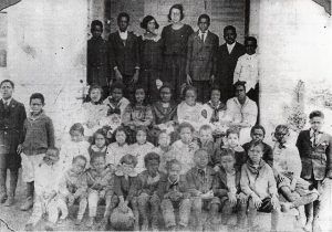 Some African-American farm workers and their families lived in the nearby Five Row community.