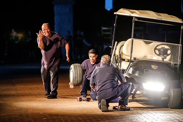 fleet workers Mark Shouse, Bruce Avelar and Mark Beckerdite turn the art of changing tires on a golf cart into a comedy routine