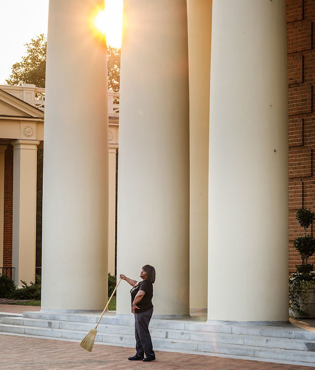 Custodian Judy Dunovant, above, practicing moves in front of Wait Chapel