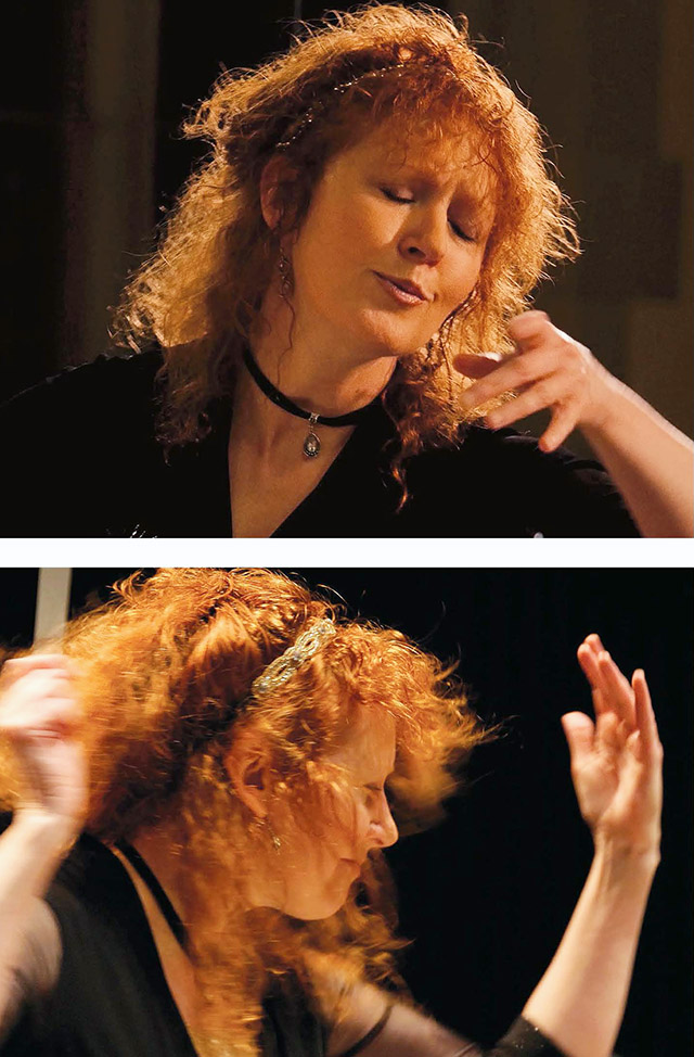 Jeanette Sorrell's red hair shines in the light as she swings her conductor's baton.