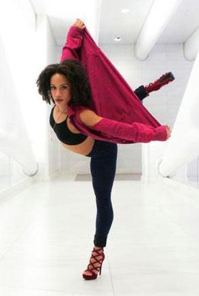Bri Butler poses in dance studio
