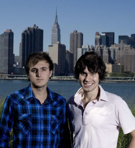 Klein and Ricky Van Veen stand in front of the New York City skyline. Their company CollegeHumor.com moved there after it was founded at Wake Forest and operated for a short time in San Diego.