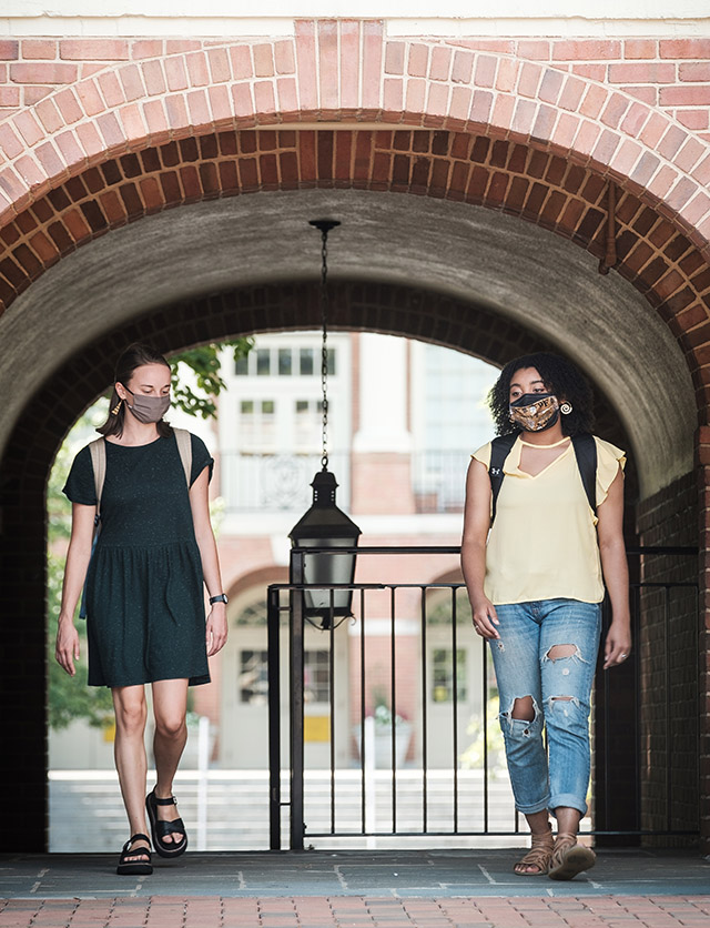 Wake Forest students and recent graduates demonstrate a socially distanced and properly masked campus, on the campus of Wake Forest University, Tuesday, July 28, 2020. Ellie Bruggen ('20) and Monet Beatty ('20) talk outside Davis Residence.