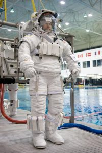 Astronaut Tom Marshburn, STS-127 mission specialist, attired in a training version of his Extravehicular Mobility Unit (EMU) spacesuit, awaits the start of a training session in the waters of the Neutral Buoyancy Laboratory (NBL) near NASA's Johnson Space Center.