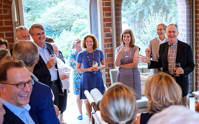 The Hatches welcome Wake Forest trustees into the President's Home.