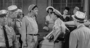 """from a clip of """"The Andy Griffith Show"""" episode """"Citizen's Arrest"""" with town mechanic Gomer Pyle facing off with Deputy Barney Fife in a crowd of Mayberry onlookers."""