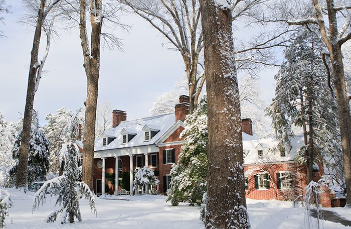 Snow blankets the grounds at the Wake Forest University President's House
