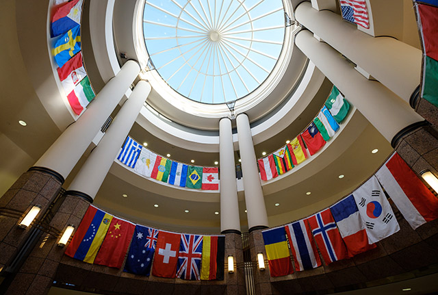 Flags from many nations hang in the atrium of the Benson Center.