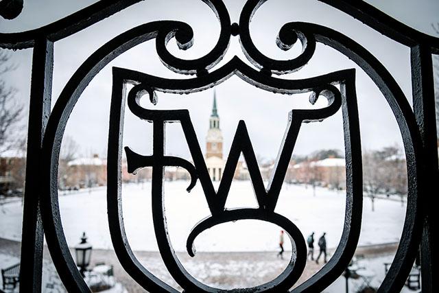 The distinctive WFC ironwork frames a snowy scene on the Quad.