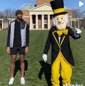 Matt James ('14) stands on the Quad with the Demon Deacon