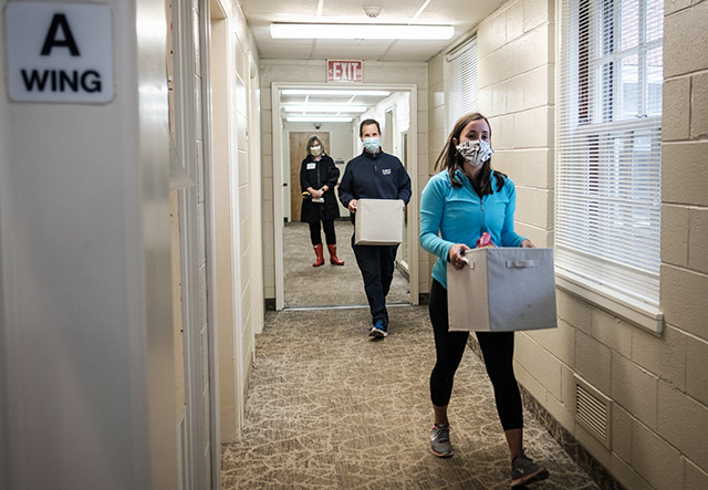 Wake Forest first year student Caitlyn Dwyer ('23) gets some help from her dad, David Dwyer, as she moves out of her room in Babcock Residence on Wednesday, May 20, 2020. The students were moving out individually over several weeks in response to the COVID-19 pandemic.