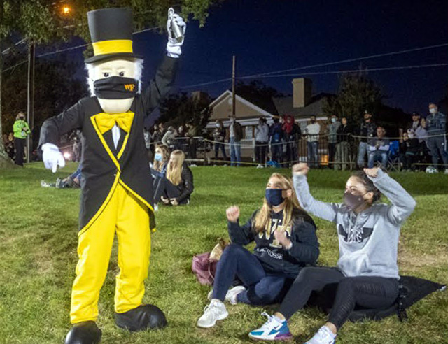 """Fans cheer on the WFU soccer teams from """"The Hill"""" overlooking Spry Stadium along Polo Road."""