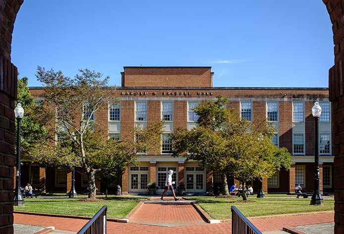 Students walk across Tribble Courtyard in front of Tribble Hall.