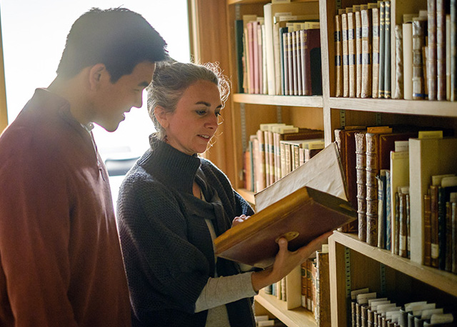 Wake Forest English professor Jessica Richard talks with senior English major Kevin Wang ('17) in the special collections are of the Z. Smith Reynolds Library