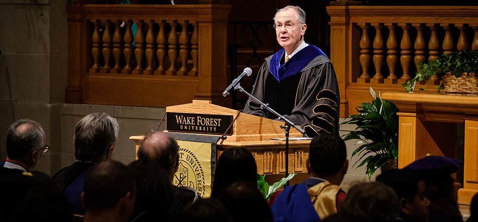Wake Forest President Nathan O. Hatch speaks at the lectern.