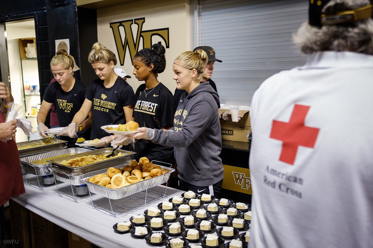 Wake Women's Soccer team serves meal at LJVM Coliseum following Hurricane Florence