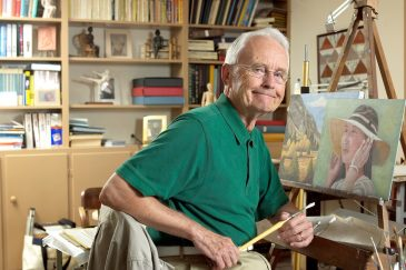 Retired Wake Forest communication professor Julian Burroughs in the art studio in the basement of his Faculty Drive home in 2004.
