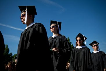 Graduates file into their seats in front of Wait Chapel.
