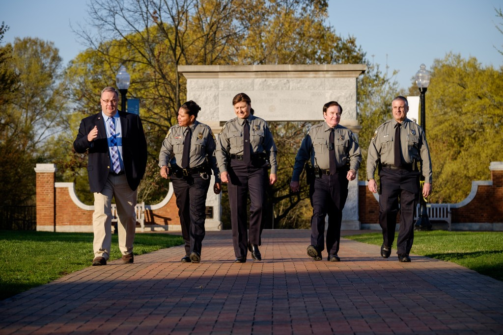 The Wake Forest police department senior leadership team has a candid discussion about campus issues on the main quad on Wednesday, March 23, 2016. The team includes Chief Regina Lawson, August Vernon, Derri Stormer, Joe Dixon, and Ken Overholt.