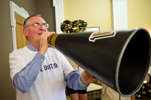 President Hatch leads the cheers at the United Way kickoff on campus last September.