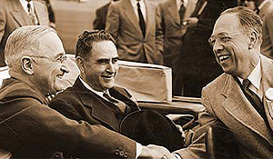 President Harry Truman shakes hands with Wake Forest President Harold Tribble.