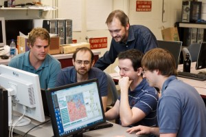 The digital ants team: professors Errin Fulp (standing) and Kenneth Berenhaut (second from left) and students Ross Hilton, Jacob White and Michael Crouse.