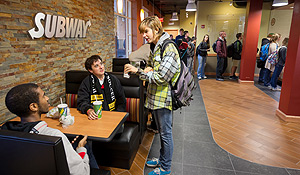Students talk inside Subway.