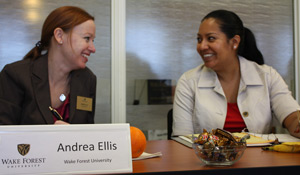 Andrea Ellis, left, talks with a colleague.