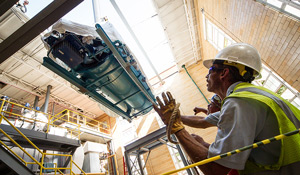 Workers install a new boiler in the Wake Forest power plant.