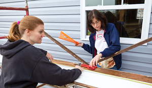 Roberta Powell, left, and Sara Blackburn of Financial Aid work on the 2010 house.