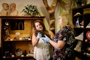Sara Cromwell, right, the assistant director of the Wake Forest Museum of Anthropology, works on the exhibit Cabinet of Curiosities, with sophomore Lindsay Gilliland ('18), one of the students who curated the exhibit, in the museum on Monday, June 15, 2015.