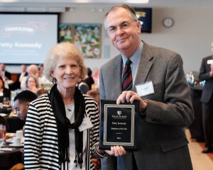 Wake Forest President Nathan O. Hatch presents staff member Patty Kennedy with the Employee of the Year plaque on Tuesday, October 11, 2016.