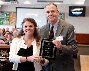 Wake Forest President Nathan O. Hatch presents staff member Betsy Chapman with the Employee of the Year plaque on Tuesday, October 11, 2016.