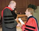 Peter H. Brubaker, right, receives award from Graduate School Dean Gordon A. Melson
