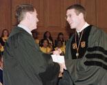 Robert H. Evans, left, receives award from ODK President Samuel E. Salatich