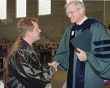 Jeffrey D. Lerner, left, receives award from Dean Paul Escott