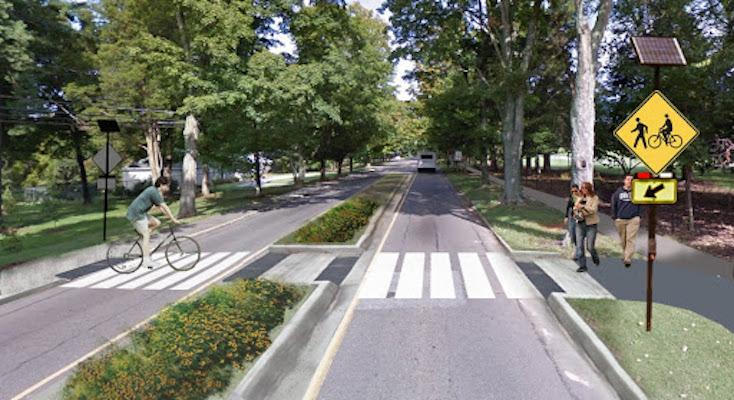 Cyclist and pedestrians used crosswalk on Reynolda Road