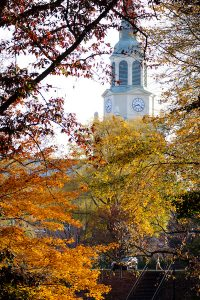 Bell tower of Wait Chapel above fall leaves