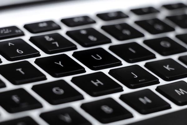 Close-up photograph of keys on a laptop keyboard