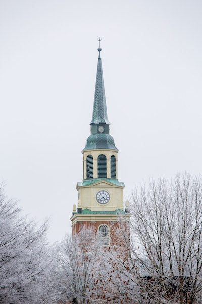 Ice-covered trees in front of the Wait Chapel spire and clock