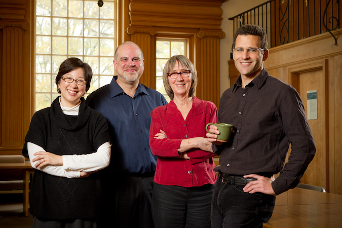 Photo of the founding faculty leadership of the Wake Forest Humanities Institute, from left, Mary Foskett, David Phillips, Sally Barbour and Dean Franco standing in Carswell Hall