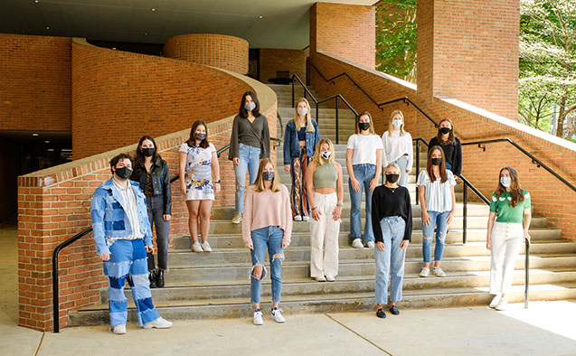 Members of the quadrennial Art Buying Class at Wake Forest wear face masks and pose for a group photo outside Scales Fine Arts Center