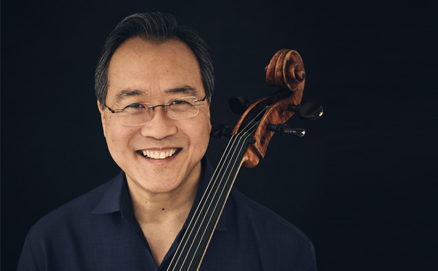 Headshot of Yo-Yo Ma standing with a cello