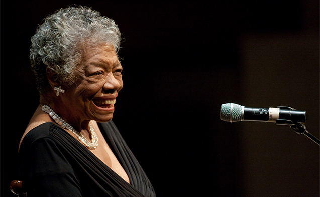Photo of Dr. Maya Angelou smiling in front of a microphone