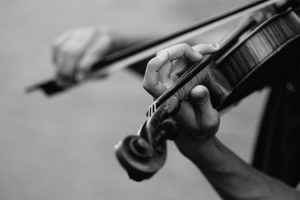 Black and white photo of a person playing a violin