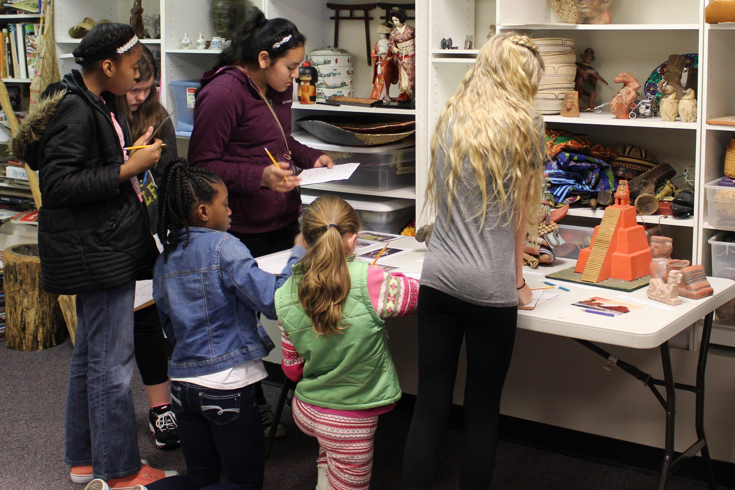 Education class participants examine artifacts