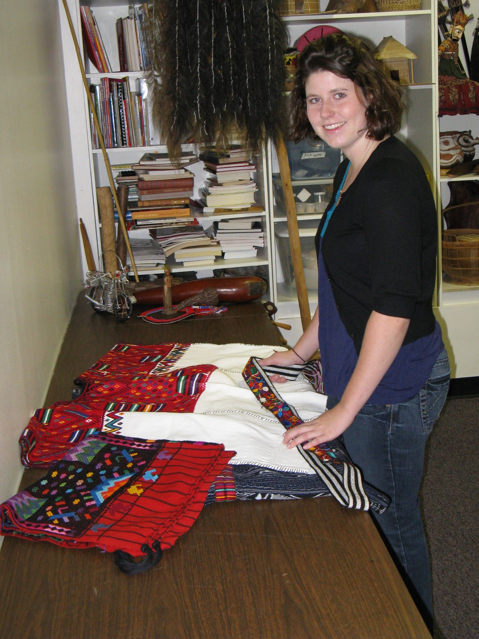 Student curator Lydia Dorsey researches clothing for the exhibit.