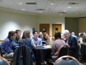 Al Hunt speaking with students at Words Awake lunch table