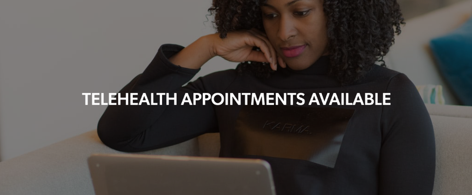 Image of woman on computer with text Telehealth appointments available